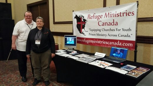 "Alan and Sharon Campbell with ""Refuge Ministries Canada"" ministry display table at the ""Apostolic Church of Pentecost "" national conference in Toronto,Ontario."